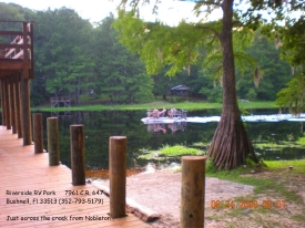 Boating down the Withlacoochee River at the Riverside RV Park two level fishing dock.